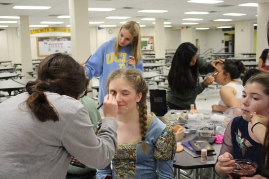 Caroline Baird (Sophomore, Rapunzel) gets her makeup done.